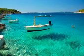 Picturesque scene of boats in a quiet bay of Milna on Brac island in Croatia