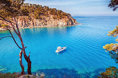 Picturesque scenery of coastline of Turkey on Mediterranean sea. Solitary luxury white yacht in the incredible bay. Summer vacation background. Location Antalya Turkey.