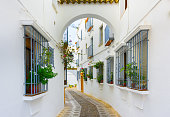 Picturesque white street of Cordoba. Typical andalusian white houses in Southern Spain.Picturesque white street of Cordoba. Typical andalusian white houses in Southern Spain.
