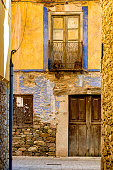 A vintage yellow old building facade in picturesque village in Northern Spain