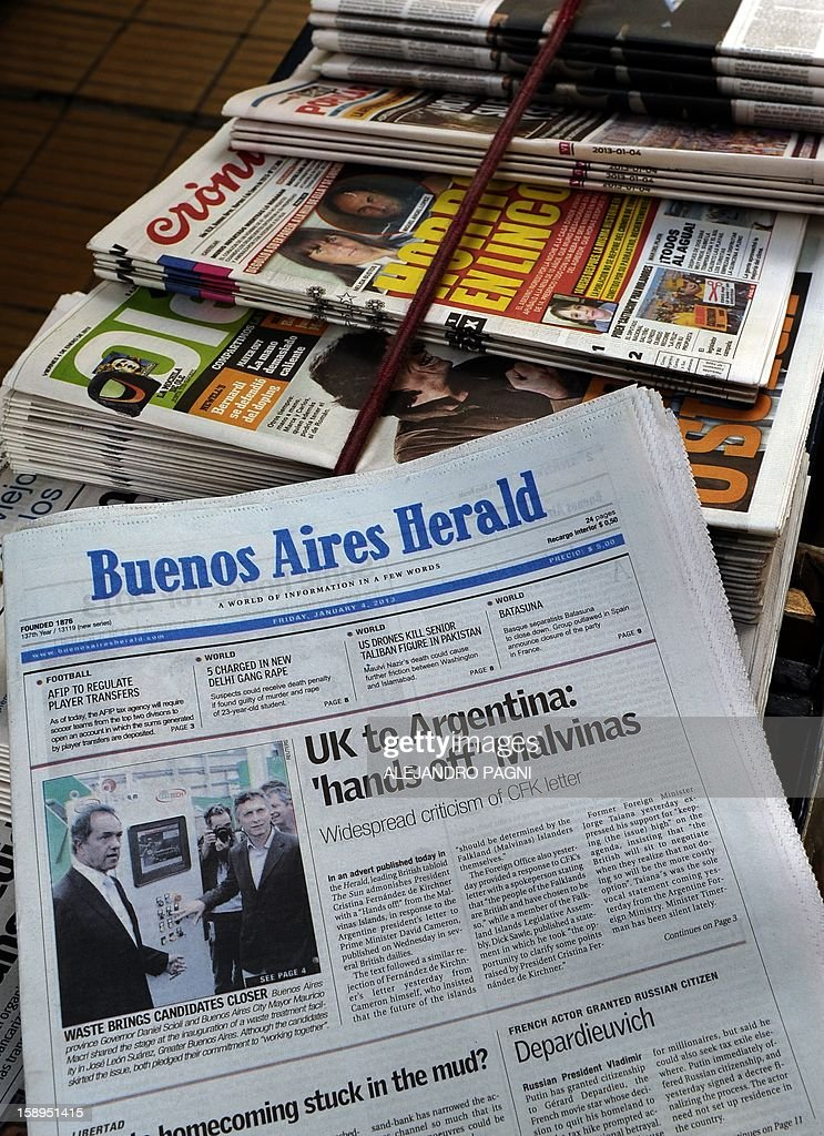 Picturte of the front page of the Buenos Aires Herald in which Britain's biggest-selling tabloid The Sun placed an advert warning Argentina to keep its 'hands off' the Falklands, taken at a newsstand in Buenos Aires, on January 4, 2013. The Sun hit back at Argentina's President Cristina Fernandez de Kirchner's renewed claim over the disputed Falkland Islands in an open letter to her in the Buenos Aires Herald newspaper on Friday, a day after Fernandez de Kirchner published her own open letter in two British newspapers urging Britain to give up the South Atlantic islands. AFP PHOTO/ALEJANDRO PAGNI