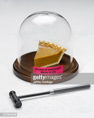 Pie Under Glass With Hammer : Stock Photo