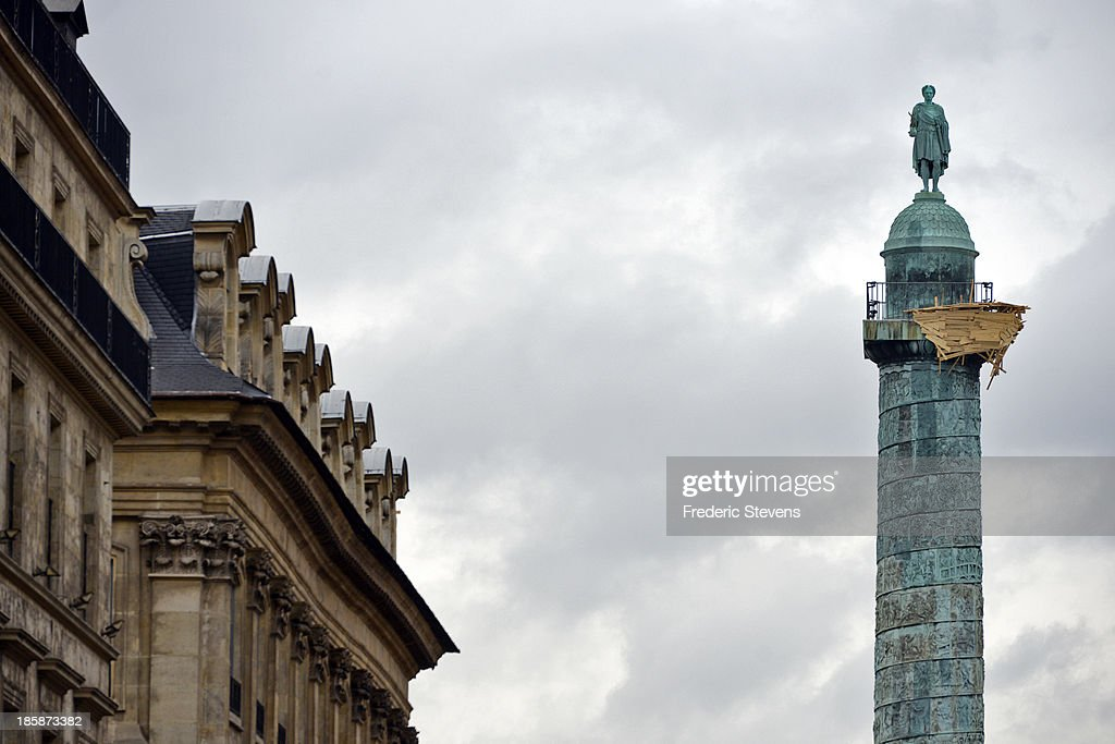 A piece by Japanese artist Tadashi Kawamata entitled 'Tree Huts at Place Vendome' is seen on the landmark Colonne Vendome as part of the outdoor exhibition of the FIAC International Contemporary Art Fair on October 25, 2013 in Paris, France. This is the 40th anniversary edition of