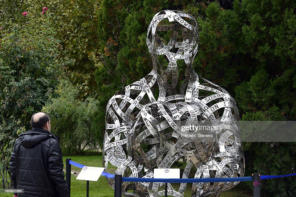 A piece by Spanish artist Jaume Plensa untitled 'Thoughts' is seen at the Jardin des Plantes in Paris as part of the outdoor exhibition of the FIAC International Contemporary Art Fair on October 25, 2013 in Paris, France. This is the 40th anniversary edition of
