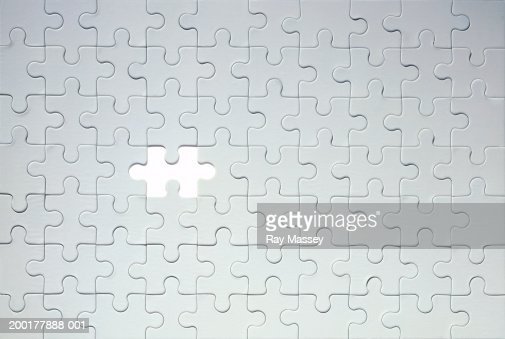 Piece missing from grey jigsaw puzzle