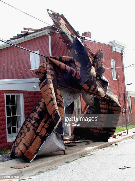 Piece of a building wrapped around a seperate building following a tornado