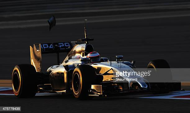 A piece of bodywork falls from the car of Kevin Magnussen of Denmark and McLaren as he drives during day three of Formula One Winter Testing at the...