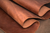 A piece of brown leather. Texture of natural material.