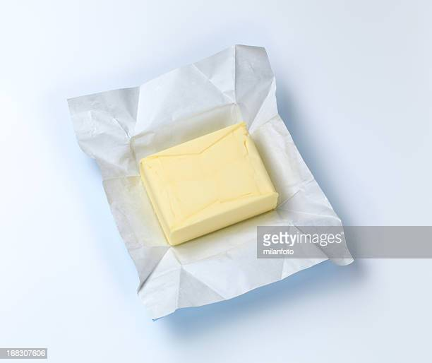 A piece of butter recently open from the package