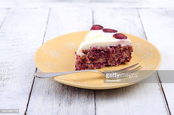 Piece of carrot cake with lemon curd on plate