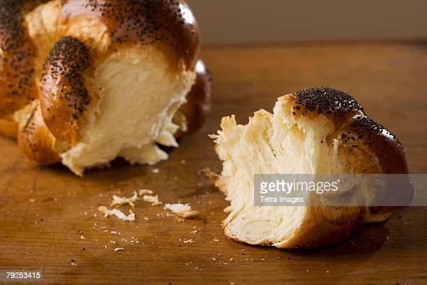 Piece of Challah bread broken off of loaf