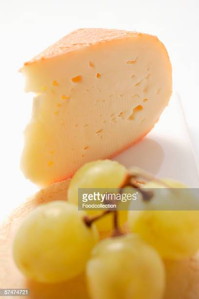 Piece of Chaumes cheese with green grapes