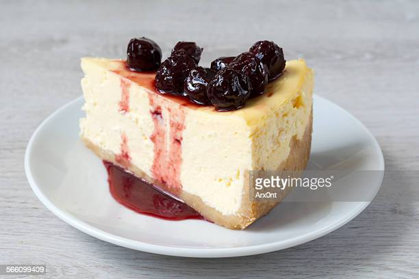 Piece of cheesecake topped with cherry compote