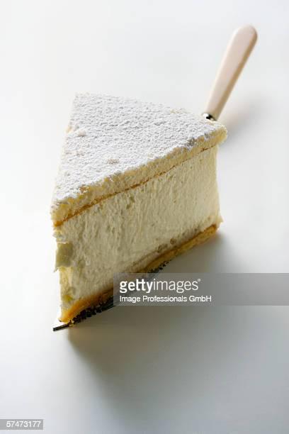 Piece of cream cheesecake on cake slice