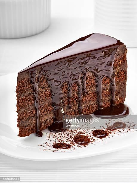 Piece of cream chocolate cake on white plate