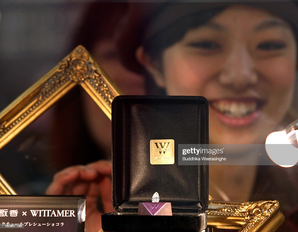 A piece of diamond shape chocolate with a 2.3 carat diamond in the centre on display at a Hanshin Department Store on February 6, 2013 in Osaka, Japan. The chocolate is priced priced at 3 million yen (about USD 32,456), making it the world's most expensive chocolate.