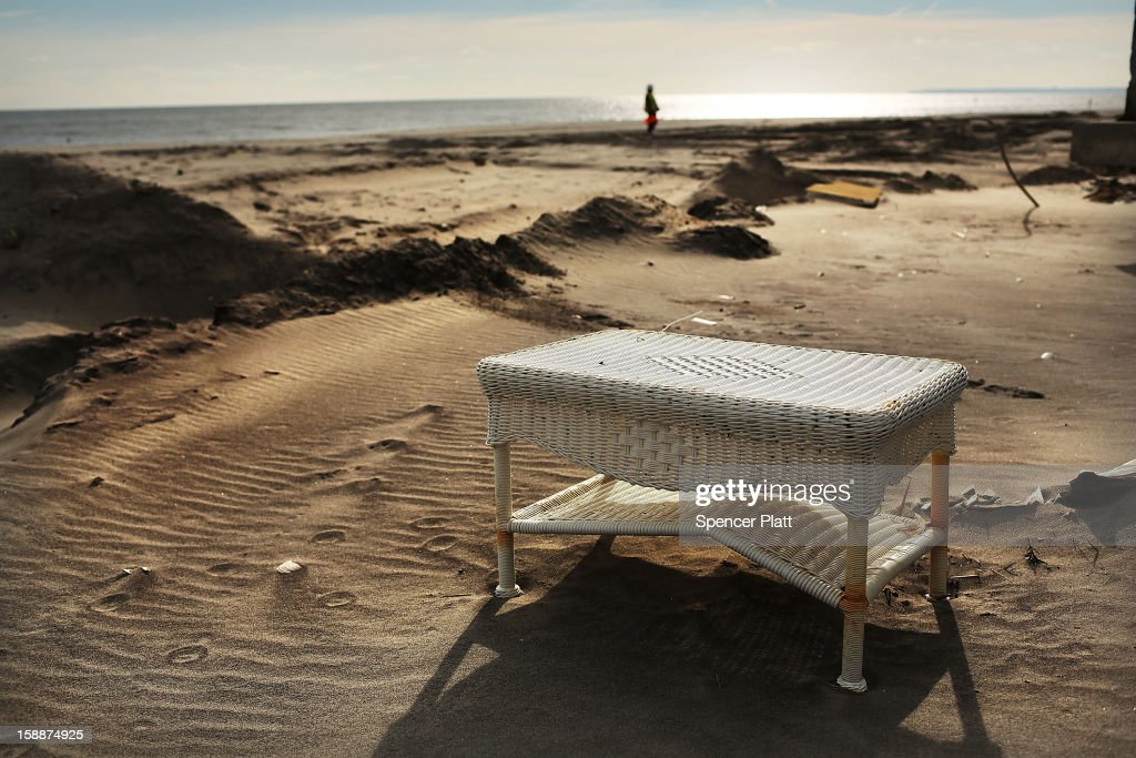 A piece of furniture from a destroyed home sits on the beach in the Belle Harbor neighborhood in the Rockaways on January 2, 2013 in the Queens borough of New York City. Criticism, including by President Barack Obama, has been directed at the Republican House's decision to adjourn without passing a Superstorm Sandy aid bill. According to early estimates, Superstorm Sandy inflicted at least $50 to $60 billion in damage across the Northeast, making it one of the most destructive storms ever.