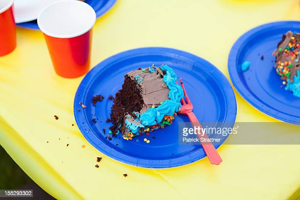 A piece of half eaten cake on a disposable plate