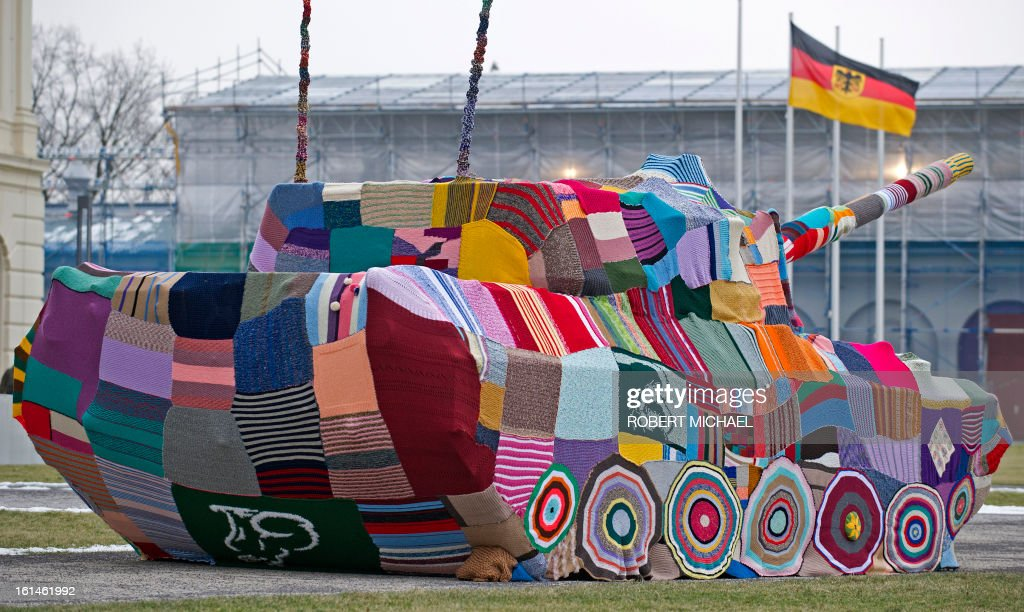 A piece of knitted fabric coveres a tank which stands in front of the Museum of Military History in Dresden, eastern Germany, on February 11, 2013. The Leopard I tank takes a stand with a cross-generational handicrafts project against war and violence on the occasion of 68th anniversary of the bombing of Dresden.