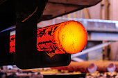 Hot steel blanks coming out of furnace