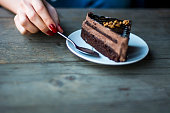 Piece of of chocolate cake on the table