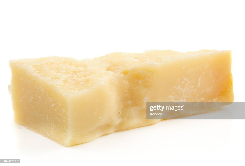 Piece of parmesan cheese isolated on white : Stock Photo