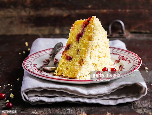 Piece of pound crumb lemon cake with fresh berry on a dessert plate