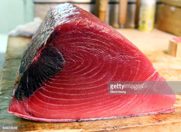 A piece of raw tuna is pictured at the Tsukiji Fish Market in Tokyo Japan Monday June 5 2006 Wholesale prices for Japan's favorite fish have surged...