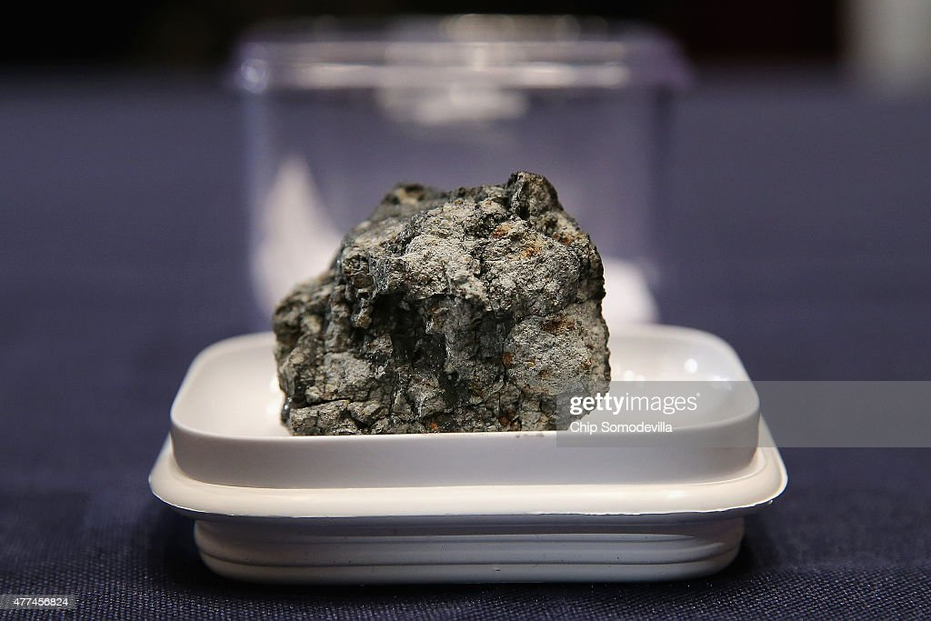 A piece of the Chelyabinsk meteorite is displayed before a hearing of the House Administration Committee in the Longworth House Office Building on...