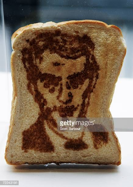 A piece of toast with a portrait of actor Jude Law sits on display during the Marmart exhibition at the Air Gallery on October 23 2006 in London...