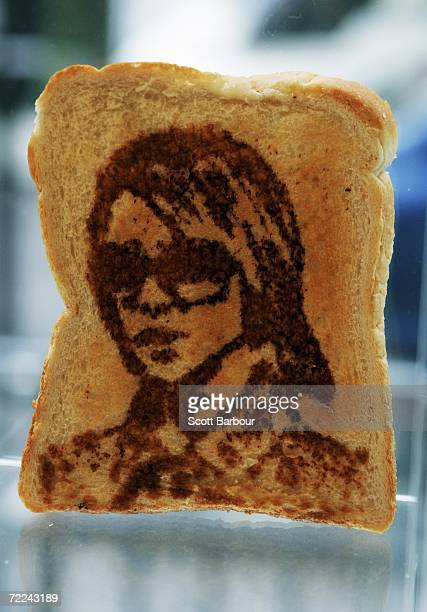 A piece of toast with a portrait of Victoria Beckham sits on display during the Marmart exhibition at the Air Gallery on October 23 2006 in London...