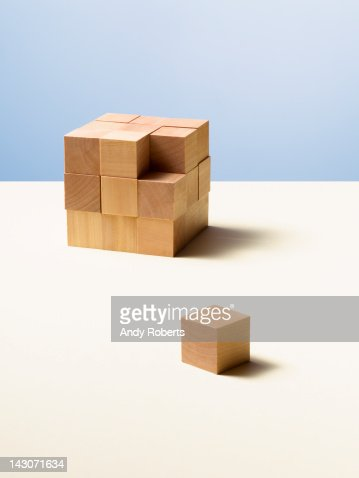Piece of wooden cube separate from whole