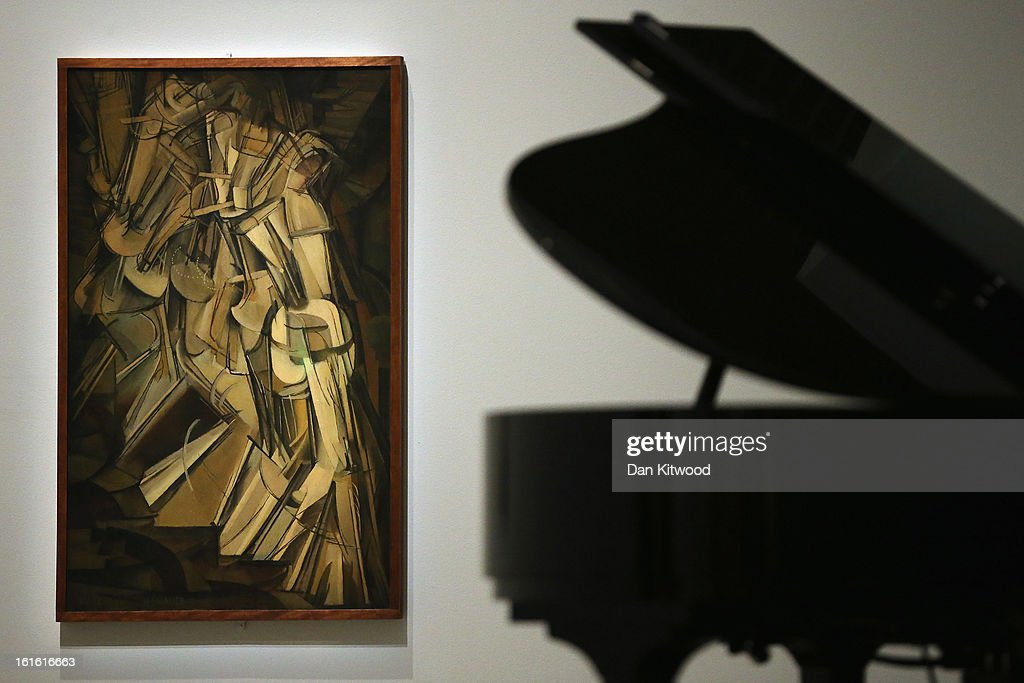 A piece of work entitled Nude Descending a Staircase by Marcel Duchamp is displayed during a press preview of 'The Bride and the Bachelors'...