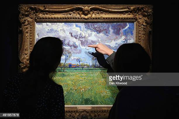 A piece of work entitled 'Paysage sous un ciel mouvemente' by Vincent Van Gogh hangs in Sotheby's auction house on October 9 2015 in London England...