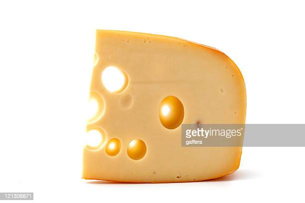 A piece of yellow cheese by itself