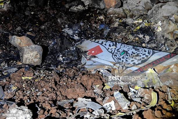 Pieces of a crashed Turkish F16 war plane are pictured on December 12 2016 in Diyarbakir A Turkish fighter jet crashed near an airport in the...