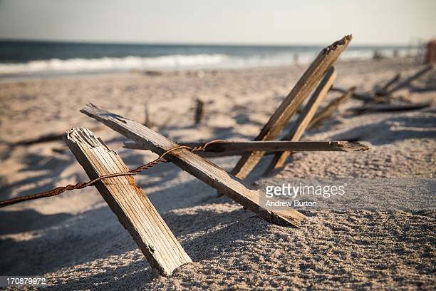 Pieces of a fence remain along the dunes at Smith Point Beach near the TWA 800 International Memorial which is dedicated to the 230 people who died...