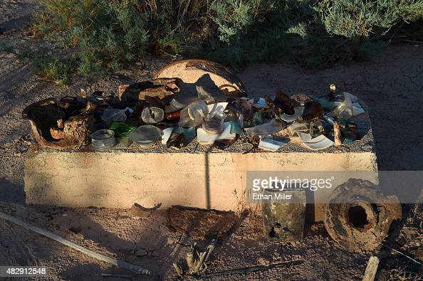 Pieces of broken glass rusted metal and other artifacts are shown in the ghost town of St Thomas on August 3 2015 in the Lake Mead National...