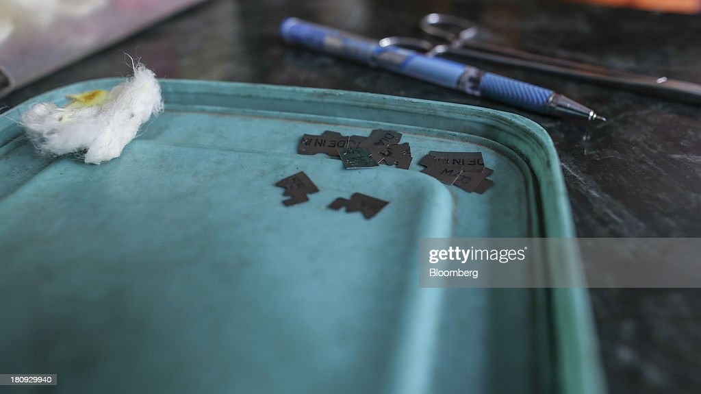 Pieces of broken razor blades used for skin smear tests are placed in a rubber lid on a desk at the Bombay Leprosy Project (BLP) referral center in Mumbai, India, on Tuesday, Sept. 10, 2013. While leprosy, described in Indian texts from the 6th century BC, has been cleared from the developed world, its regaining ground in India, which has become the biggest source of cases imported into the U.K. and Australia. Photographer: Dhiraj Singh/Bloomberg via Getty Images