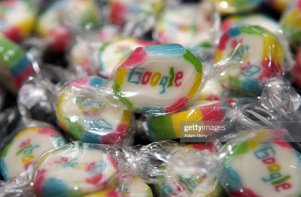 Pieces of candy featuring the Google logo are seen on September 26, 2012 at the official opening party of the Google offices in Berlin, Germany. Although the American company holds 95% of the German search engine market share and already has offices in Hamburg and Munich, its new offices on the prestigious Unter den Linden avenue are its first in the German capital. The Internet giant has been met with opposition in the country recently by the former president's wife, who has sued it based on search results for her name that she considers derogative. The European Commission has planned new data privacy regulations in a country where many residents opted in to have their homes pixeled out when the company introduced its Street View technology.