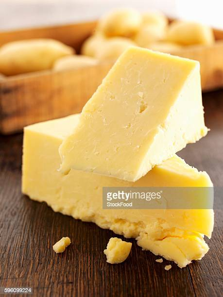 Pieces of Cheddar cheese stacked