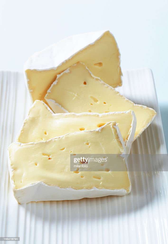 Pieces of cheese brie on a tray