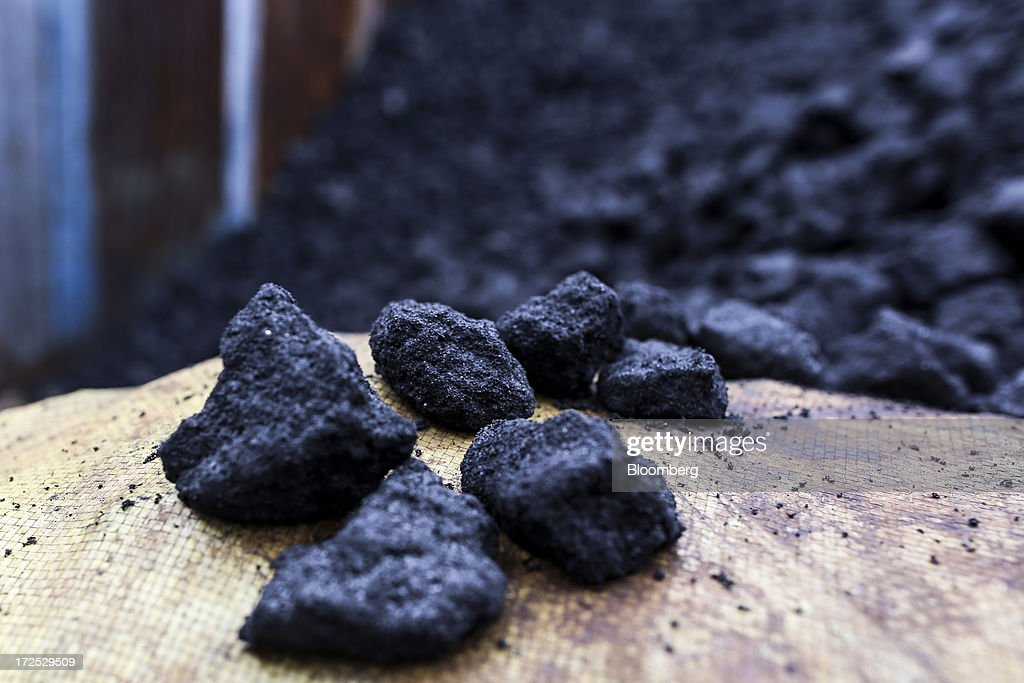 Pieces of coal sit on a sack at a coal wholesale market in Mumbai, India, on Tuesday, July 2, 2013. India, the worlds third-largest coal consumer, imported 43 percent more of the fuel than a year ago on increased demand from power stations and steelmakers, according to shipping data, and is set to eclipse China as the top importer of power station coal by 2014. Photographer: Dhiraj Singh/Bloomberg via Getty Images