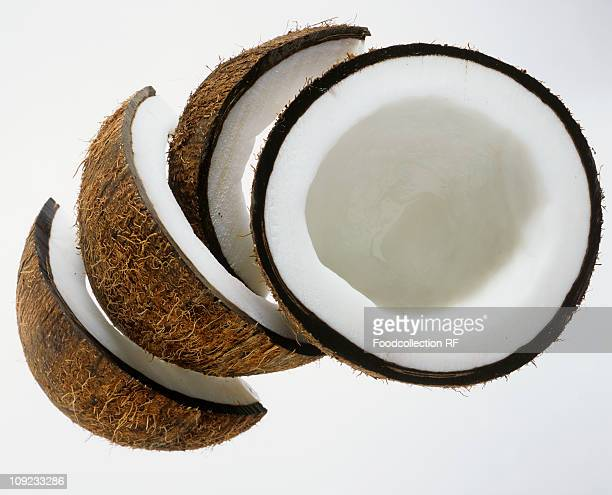 Pieces of coconut against white background, Close-Up