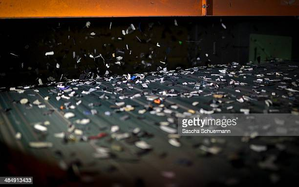 Pieces of electronic components including circuit boards are recycled in the Aurubis metal refinery on a conveyor belt on February 7 2014 in Luenen...