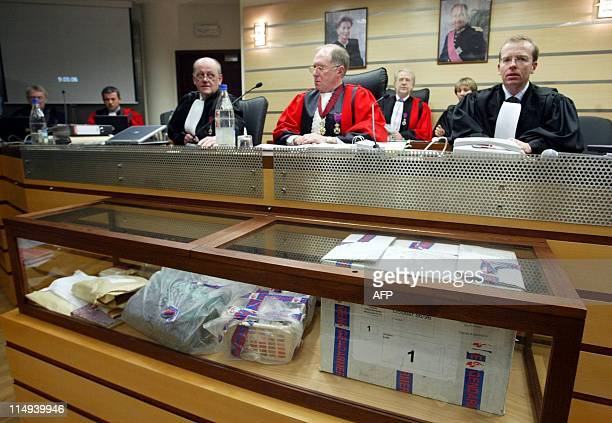 Pieces of evidence are displayed in front of presiding judge Stephane Goux and assessor judges Michel Borgerf and Thierry Lambert ahead of the start...