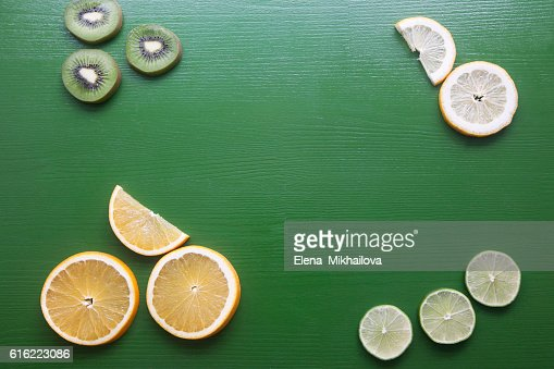 Pieces of fruit on a green background : Stock Photo