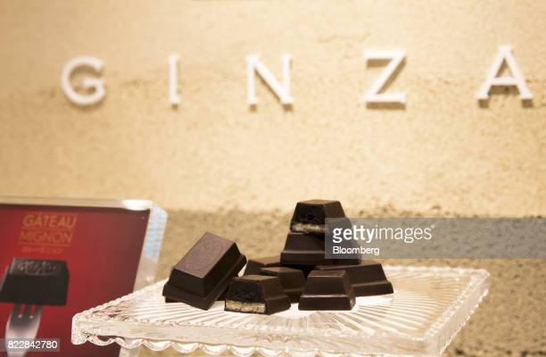 Pieces of Gateau Mignon KitKat are displayed during a media preview of the KitKat Chocolatory Ginza store operated by Nestle SA in Tokyo Japan on...
