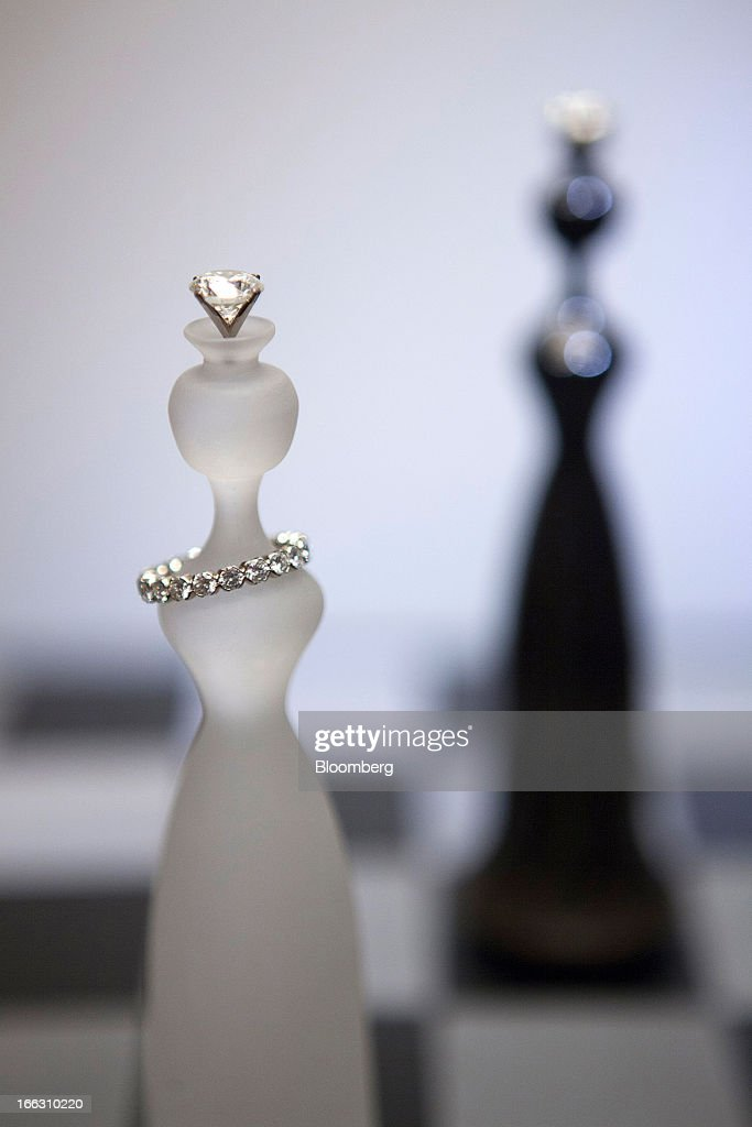 Pieces of luxury diamond art jewelry sit on display at the Kremlin Museum during an exhibition by OAO Alrosa in Moscow, Russia, on Thursday, April 11, 2013. OAO Alrosa may be valued at $9.4-10.8B when the Russian government looks to sell stake in the company in November, Vedomosti newspaper says, citing two unidentified bankers close to Goldman Sachs. Photographer: Alexander Zemlianichenko Jr./Bloomberg via Getty Images