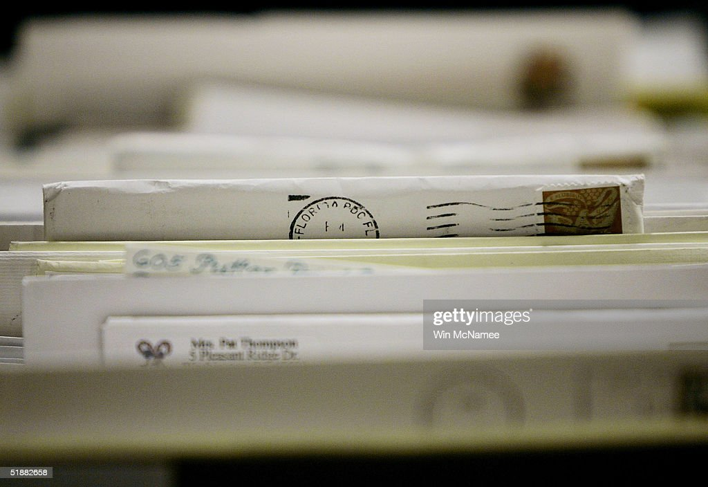 Pieces of mail wait to be sorted at the Merrifield Postal Center December 20 2004 in Merrifield Virginia The Monday before Christmas is the busiest...